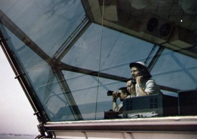 Color photo of WAVE working as aircraft control tower operator